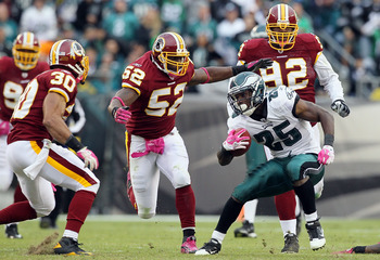 PHILADELPHIA - OCTOBER 03:  LeSean McCoy #25 of the Philadelphia Eagles looks for room to run the ball against Rocky McIntosh #52 of the Washington Redskins on October 3, 2010 at Lincoln Financial Field in Philadelphia, Pennsylvania.  (Photo by Jim McIsaa
