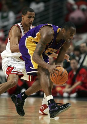 CHICAGO - DECEMBER 19:  Kobe Bryant #24 of the Los Angeles Lakers runs down a loose ball as Thabo Sefolosha #2 of the Chicago Bulls defends on December 19, 2006 at the United Center in Chicago, Illinois. The Bulls defeated the Lakers 94-89. NOTE TO USER:
