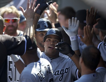 SEATTLE, WA - AUGUST 28: Dayan Viciedo #24 of the Chicago White Sox is congratulated by teammates after hitting a three-run home run against the Seattle Mariners during a game at Safeco Field on August 28, 2011 in Seattle, Washington. (Photo by Stephen Br