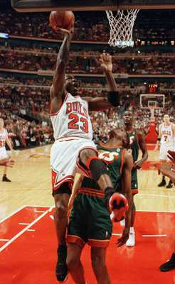 16 Jun 1996: Chicago Bull Michael Jordan puts up a shot over Seattle Supersonics'' Sam Perkins during second quarter action in game six of the 1996 NBA finals at the United Center in Chicago, Illinois. The Bulls came into the game leading in the best of s