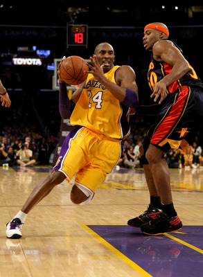 LOS ANGELES - NOVEMBER 15:  Kobe Bryant #24 of the Los Angeles Lakers drives around Corey Maggette #50 of the Golden State Warriors on December 29, 2009 at Staples Center in Los Angeles, California.  NOTE TO USER: User expressly acknowledges and agrees th