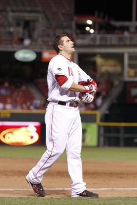 CINCINNATI, OH - AUGUST 29: Joey Votto #19 of the Cincinnati Reds reacts after grounding out to end the eighth inning against the Philadelphia Phillies at Great American Ball Park on August 29, 2011 in Cincinnati, Ohio. The Phillies won 3-2. (Photo by Joe