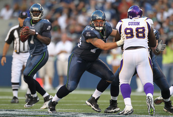 SEATTLE - AUGUST 20:  Guard John Moffitt #74 of the Seattle Seahawks pass blocks against Letroy Guion #98 of the Minnesota Vikings at CenturyLink Field on August 20, 2011 in Seattle, Washington. The Vikings won 20-7. (Photo by Otto Greule Jr/Getty Images)