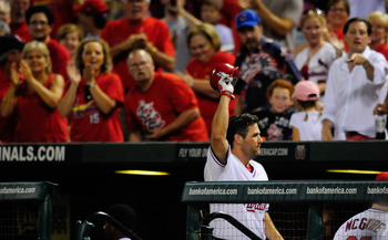 ST. LOUIS, MO - AUGUST 26: Lance Berkman #12 of the St. Louis Cardinals salutes the fans after hitting a two-run home run against the Pittsburgh Pirates at Busch Stadium on August 26, 2011 in St. Louis, Missouri.  (Photo by Jeff Curry/Getty Images)