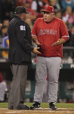 SEATTLE - AUGUST 30:  Manager Mike Scioscia #14 of the Los Angeles Angels of Anaheim argues with home plate umpire Hunter Wendelstedt after Brendan Ryan of the Seattle Mariners was ruled to be hit by a pitch at Safeco Field on August 30, 2011 in Seattle,