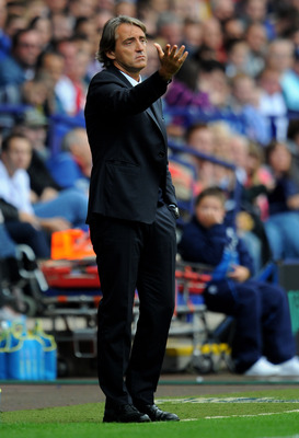 BOLTON, ENGLAND - AUGUST 21:  Manchester City Manager Roberto Mancini gestures during the Barclays Premier League match between Bolton Wanderers and Manchester City at the Reebok Stadium on August 21, 2011 in Bolton, England.  (Photo by Michael Regan/Gett