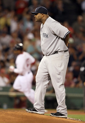 BOSTON, MA - AUGUST 30: CC Sabathia #52 of the New York Yankees reacts as Carl Crawford #13 of the Boston Red Sox rounds third after his solo home run in the fourth inning on August 30, 2011 at Fenway Park in Boston, Massachusetts.  (Photo by Elsa/Getty I