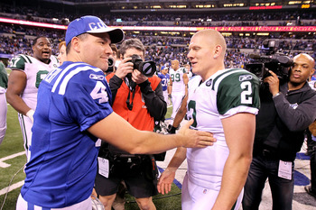 INDIANAPOLIS, IN - JANUARY 08:  Kicker Adam Vinatieri #4 (L) of the Indianapolis Colts congratulates kicker Nick Folk #2 of the New York Jets after Folk kicked a game-winning 32-yard field goal as time expired to give the Jets a 17-16 win during their 201