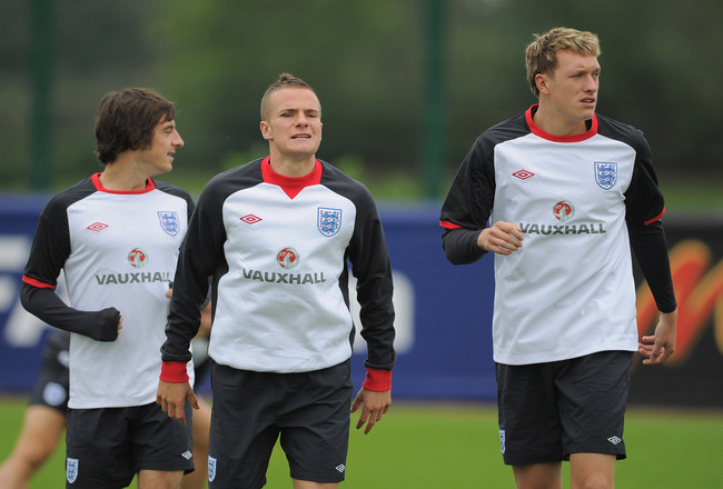 LONDON, ENGLAND - AUGUST 30:  Leighton Baines, Tom Cleverley and Phil Jones warm up during the England training session ahead of their UEFA EURO 2012 Group G qualifier against Bulgaria at London Colney on August 30, 2011 in London, England.  (Photo by Mic