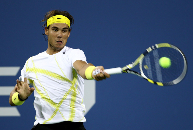 NEW YORK, NY - AUGUST 30:  Rafael Nadal of Spain returns a shot against Andrey Golubev of Kazakhstan during Day Two of the 2011 US Open at the USTA Billie Jean King National Tennis Center on August 30, 2011 in the Flushing neighborhood of the Queens borou