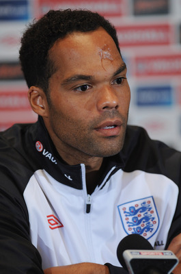 LONDON, ENGLAND - AUGUST 30: Joleon Lescott speaks to the media during the England press conference ahead of their UEFA EURO 2012 Group G qualifier against Bulgaria at London Colney on August 30, 2011 in London, England.  (Photo by Michael Regan/Getty Ima