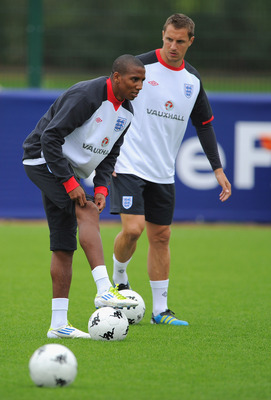 LONDON, ENGLAND - AUGUST 30: Ashley Young and Phil Jagielka warm up during the England training session ahead of their UEFA EURO 2012 Group G qualifier against Bulgaria at London Colney on August 30, 2011 in London, England.  (Photo by Michael Regan/Getty