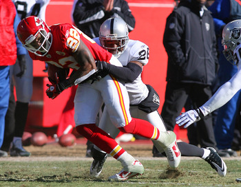 KANSAS CITY, MO - JANUARY 02:  Wide receiver Dwayne Bowe #82 of the Kansas City Chiefs is tackled by Stanford Routt #26 of the Oakland Raiders in a game at Arrowhead Stadium on January 2, 2011 in Kansas City, Missouri.  (Photo by Tim Umphrey/Getty Images)