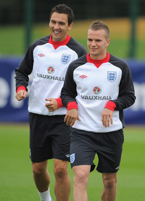 LONDON, ENGLAND - AUGUST 30:  Tom Cleverley and Stewart Downing warm up during the England training session ahead of their UEFA EURO 2012 Group G qualifier against Bulgaria at London Colney on August 30, 2011 in London, England.  (Photo by Michael Regan/G
