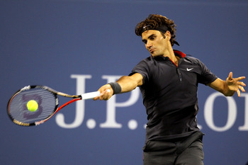 NEW YORK, NY - AUGUST 29:  Roger Federer of  Switzerland returns the ball against Santiago Giraldo of Colombia during Day One of the 2011 US Open at the USTA Billie Jean King National Tennis Center on August 29, 2011 in the Flushing neighborhood of the Qu