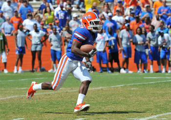 GAINESVILLE, FL - APRIL 9:  Wide receiver Robert Clark #7 of the Florida Gators returns a kick during the Orange and Blue spring football game April 9, 2011 at Ben Hill Griffin Stadium in Gainesville, Florida.  (Photo by Al Messerschmidt/Getty Images)