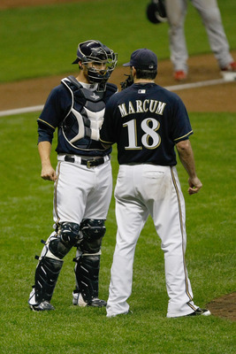 MILWAUKEE, WI - AUGUST 30: Shaun Marcum #18 of the Milwaukee Brewers talks with Jonathan Lucroy #20 during the game against the St. Louis Cardinals at Miller Park on August 30, 2011 in Milwaukee, Wisconsin. (Photo by Scott Boehm/Getty Images)