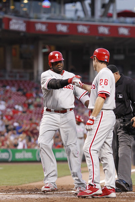 CINCINNATI, OH - AUGUST 30: Ryan Howard #6 and Chase Utley #26 of the Philadelphia Phillies celebrate after Howard's two-run home run in the fourth inning against the Cincinnati Reds at Great American Ball Park on August 30, 2011 in Cincinnati, Ohio. (Pho