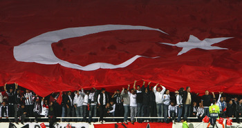 ISTANBUL, TURKEY - OCTOBER 24:  Besiktas fans with the Turkish Flag during the UEFA Champions League Group A match between Besiktas and Liverpool at the Inonu Stadium on October 24, 2007 in Istanbul, Turkey.  (Photo by Laurence Griffiths/Getty Images)