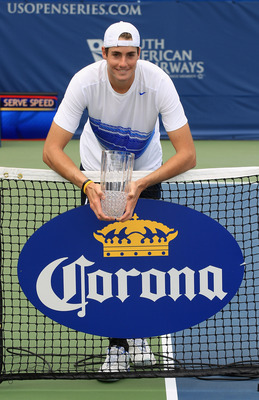 WINSTON-SALEM, NC - AUGUST 27:  John Isner of the USA holds the trophy after defeating Julien Benneteau of France during the men's singles final of the Winston-Salem Open at the Wake Forest University Tennis Complex on August 27, 2011 in Winston-Salem, No