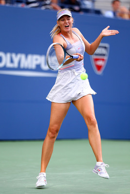 NEW YORK, NY - AUGUST 29:  Maria Sharapova of Russia returns the ball against Heather Watson of Great Britian during Day One of the 2011 US Open at the USTA Billie Jean King National Tennis Center on August 29, 2011 in the Flushing neighborhood of the Que