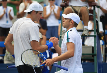WINSTON-SALEM, NC - AUGUST 26:  (L-R) John Isner of the USA shakes hands with Andy Roddick of the USA after defeating Roddick in the semifinals of the Winston-Salem Open at the Wake Forest University Tennis Complex on August 26, 2011 in Winston-Salem, Nor