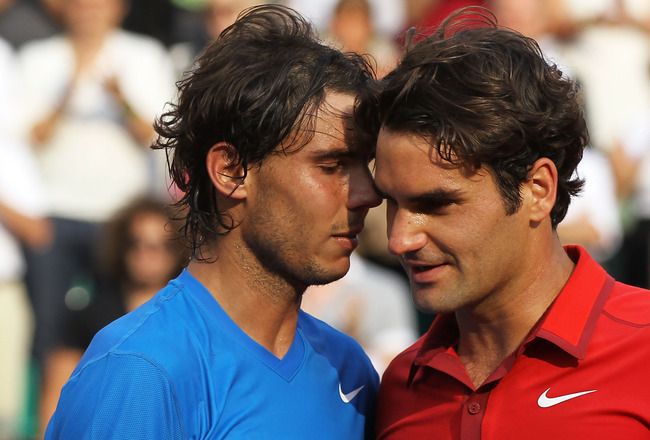 PARIS, FRANCE - JUNE 05:  Rafael Nadal of Spain shakes hands with Roger Federer of Switzerland following his victory during the men's singles final match between Rafael Nadal of Spain and Roger Federer of Switzerland on day fifteen of the French Open at R