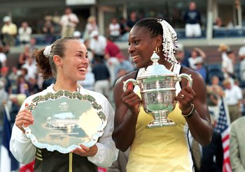 11 Sep 1999:  Serena Williams of the USA and Martina Hingis of Switzerland smile and pose with their trophies after their match in the US Open at the USTA National Tennis Center in Flushing Meadows, New York. Williams defeated Hingis 6-3, 7-6 (7-4). Manda
