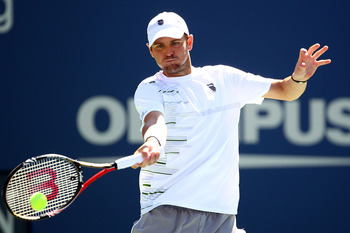 NEW YORK, NY - AUGUST 29:  Mardy Fish returns the ball against Tobias Kamke of Germany during Day One of the 2011 US Open at the USTA Billie Jean King National Tennis Center on August 29, 2011 in the Flushing neighborhood of the Queens borough of New York