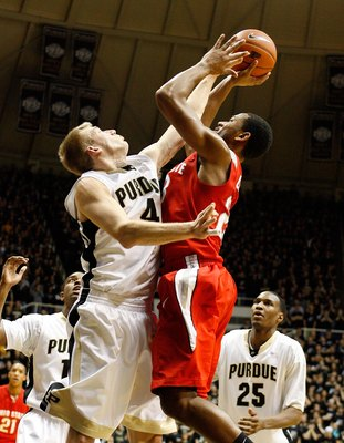 WEST LAFAYETTE, IN - JANUARY 12:  Robbie Hummel #4 of the Purdue Boilermakers defends during the Big Ten game against the Ohio State Buckeyes at Mackey Arena on January 12, 2010 in West Lafayette, Indiana. Ohio State won 70-66.  (Photo by Andy Lyons/Getty
