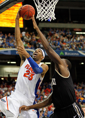 ATLANTA, GA - MARCH 12:  Alex Tyus #23 of the Florida Gators shoots against Festus Ezeli #3 of the Vanderbilt Commodores during the semifinals of the SEC Men's Basketball Tournament at Georgia Dome on March 12, 2011 in Atlanta, Georgia.  (Photo by Kevin C