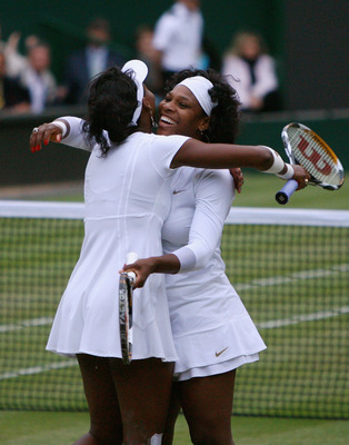 LONDON - JULY 05:  Venus Williams of United States and Serena Williams of United States celebrate match point and winning the women's doubles Final match against Lisa Raymond of United States and Samantha Stosur of Australia on day twelve of the Wimbledon