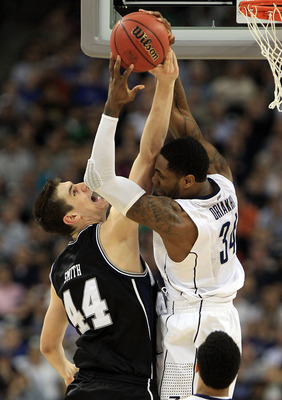 HOUSTON, TX - APRIL 04:  Andrew Smith #44 of the Butler Bulldogs fights for the ball against Alex Oriakhi #34 of the Connecticut Huskies during the National Championship Game of the 2011 NCAA Division I Men's Basketball Tournament at Reliant Stadium on Ap