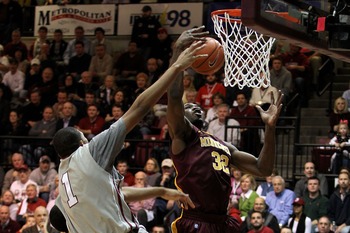 PHILADELPHIA, PA - DECEMBER 08:  Trevor Mbake #32 of the Minnesota Golden Gophers controls a rebound against C.J. Aiken #1 of the St. Joseph's Hawks at Michael J. Hagan Arena on December 8, 2010 in Philadelphia, Pennsylvania.  (Photo by Chris Chambers/Get