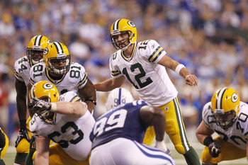 INDIANAPOLIS, IN - AUGUST 26: Aaron Rodgers #12 of the Green Bay Packers calls a play at the line during the first half of an NFL preseason game against the Indianapolis Colts at Lucas Oil Stadium on August 26, 2011 in Indianapolis, Indiana. (Photo by Joe