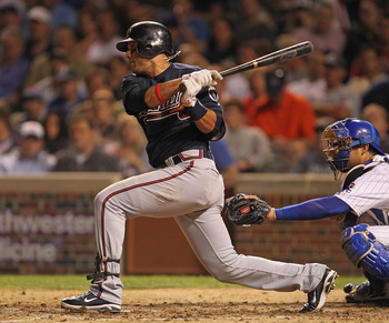 CHICAGO, IL - AUGUST 23: Martin Prado #14 of the Atlanta Braves takes a swing against the Chicago Cubs at Wrigley Field on August 23, 2011 in Chicago, Illinois. The Braves defeated the Cubs 5-4. (Photo by Jonathan Daniel/Getty Images)