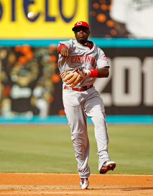 MIAMI GARDENS, FL - AUGUST 24:  Brandon Phillips #4 of the Cincinnati Reds makes a throw to first during game one of a doubleheader against the Florida Marlins at Sun Life Stadium on August 24, 2011 in Miami Gardens, Florida.  (Photo by Mike Ehrmann/Getty