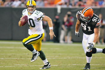 CLEVELAND, OH - AUGUST 13: Brian Schaefering #91 of the Cleveland Browns pursues Matt Flynn #10 of the Green Bay Packers during the second quarter at Cleveland Browns Stadium on August 13, 2011 in Cleveland, Ohio. The Browns defeated the Packers 27-17. (P