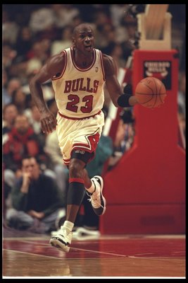 13 Dec 1995: Guard Michael Jordan of the Chicago Bulls moves down the court during a game against the Orlando Magic at the United Center in Chicago, Illinois. The Bulls won the game, 112-103.