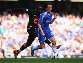 LONDON, ENGLAND - APRIL 09:  Yossi Benayoun of Chelsea evades Mohamed Diame of Wigan Athletic during the Barclays Premier League match between Chelsea and Wigan Athletic at Stamford Bridge on April 9, 2011 in London, England.  (Photo by Clive Rose/Getty I
