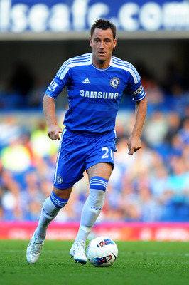 LONDON, ENGLAND - AUGUST 20:  John Terry of Chelsea runs with the ball during the Barclays Premier League match between Chelsea and West Bromwich Albion at Stamford Bridge on August 20, 2011 in London, England.  (Photo by Laurence Griffiths/Getty Images)