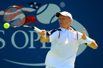 NEW YORK, NY - AUGUST 30:  Nikolay Davydenko of Russia returns a shot against Ivan Dodig of Croatia during Day Two of the 2011 US Open at the USTA Billie Jean King National Tennis Center on August 30, 2011 in the Flushing neighborhood of the Queens boroug