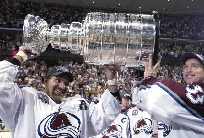 9 Jun 2001:  Ray Bourque #77 of the Colorado Avalanche and teammate Patrick Roy #33 raise the Stanley Cup after  they beat the New Jersey Devils 3-1 in game seven of the NHL Stanley Cup Finals at Pepsi Center in Denver, Colorado.  The Avalanche take the s