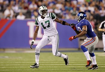 EAST RUTHERFORD, NJ - AUGUST 29:  Plaxico Burress #17 of the New York Jets tries to elude the coverage of Corey Webster #23 of the New York Giants  during their pre season game on August 29, 2011 at MetLife Stadium in East Rutherford, New Jersey.  (Photo 