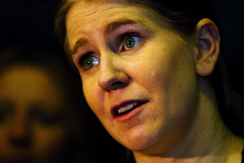 INDIANAPOLIS, IN - MARCH 12:  Tonya Harding talks to the media after a boxing exhibition during the second period intermission at the Colorado Eagles versus Indianapolis Ice hockey game at the Pepsi Coliseum on March 12, 2004 in Indianapolis, Indiana. (Ph