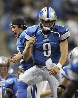 DETROIT - AUGUST 12:  Quarterback Matthew Stafford #9 and Zac Robinson #10 of the Detroit Lions celebrates a first quarter touchdown during the game against the Cincinnati Bengals at Ford Field on August 12, 2011 in Detroit, Michigan.  (Photo by Leon Hali