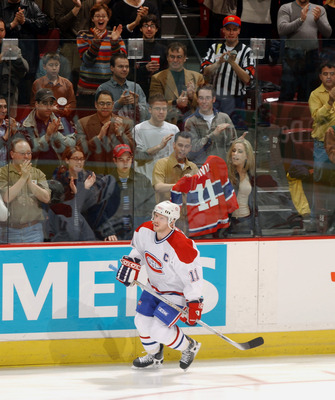 9 Apr 2002:  Saku Koivu #11 of the Montreal Canadiens skates as he recieves a standing ovation at the start of a game against the Ottawa Senators at the Molson Centre in Montreal, Canada. DIGITAL IMAGE Mandatory credit: Dave Sandford/Getty Images/NHLI