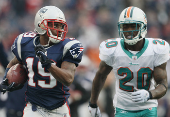 FOXBORO, MA - JANUARY 02:  Brandon Tate #19 of the New England Patriots carries the ball as Reshad Jones #20 of the Miami Dolphins chases after him on January 2, 2011 at Gillette Stadium in Foxboro, Massachusetts.  (Photo by Elsa/Getty Images)