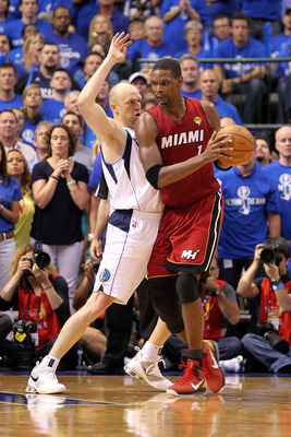 DALLAS, TX - JUNE 07:  Chris Bosh #1 of the Miami Heat posts up against Brian Cardinal #35 of the Dallas Mavericks in Game Four of the 2011 NBA Finals at American Airlines Center on June 7, 2011 in Dallas, Texas. The Mavericks won 86-83. NOTE TO USER: Use