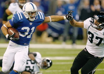 INDIANAPOLIS, IN - DECEMBER 19: Donald Brown #31 of the Indianapolis Colts runs as he is pursued by Tyron Brackenridge #37 of the Jacksonville Jaguars at Lucas Oil Stadium on December 19, 2010 in Indianapolis, Indiana.   The Colts defeated the Jaguars 34-